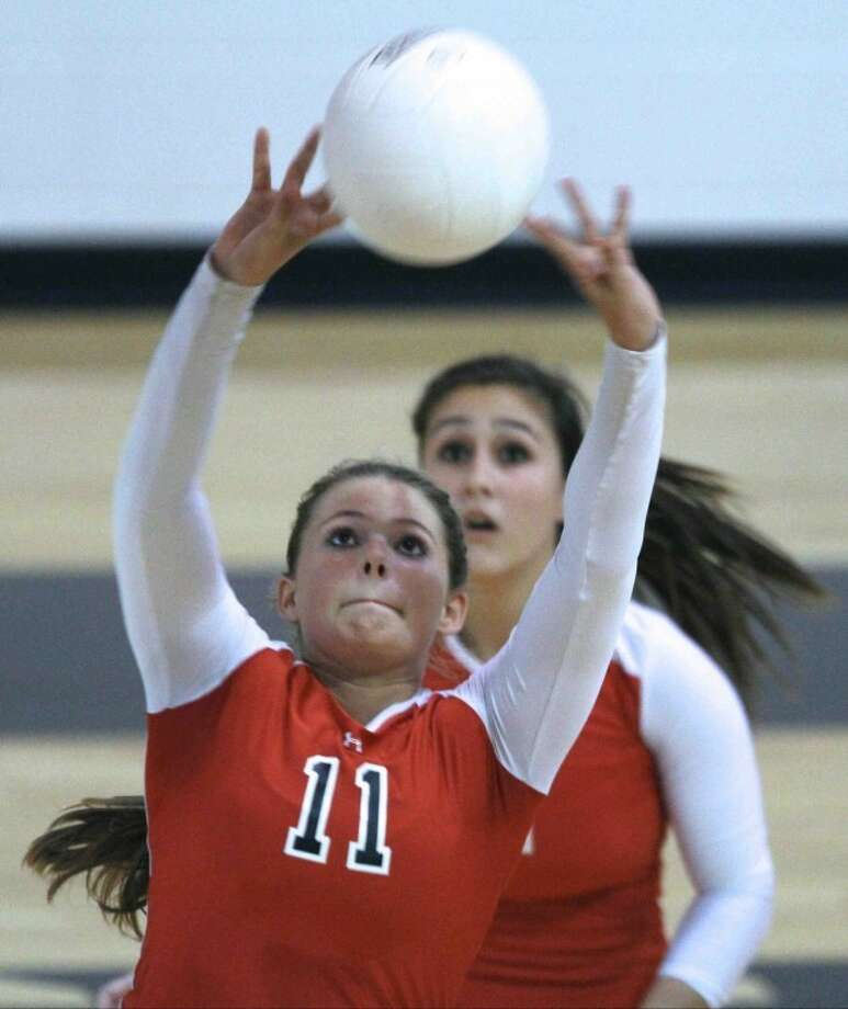 Huffman's Kelsie McEachern (11) sets up the offense during a high school volleyball game at Liberty High School on Sept. 11. Liberty defeated Huffman 3-1. Photo: Photo By Jason Fochtman
