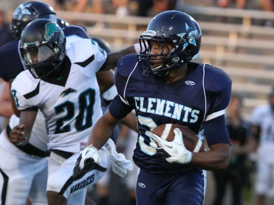 Clements DeMarcus Cobb runs against Pasadena Memorial with Ahrmon McLeod pursuing during the opening week at Mercer Stadium in Sugar Land. Cobb scored five touchdowns on Saturday as the Rangers defeated Westside 41-35 in overtime. Photo: Alan Warren/HCN