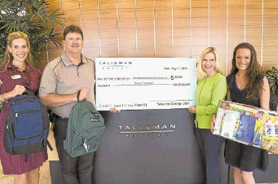 Missy Herndon, Programs and Services Director for Interfaith of The Woodlands; Scott Tompkins, Senior Advisor of Community Development for Talisman Energy; Dr. Ann Snyder, President and CEO of Interfaith of The Woodlands; and Talisman Corporate Affairs Coordinator, Sabrina Waggoner during the Talisman Energy School Supply Assistance donation on Tuesday, May 28, 2013. / @WireImgId=2634787