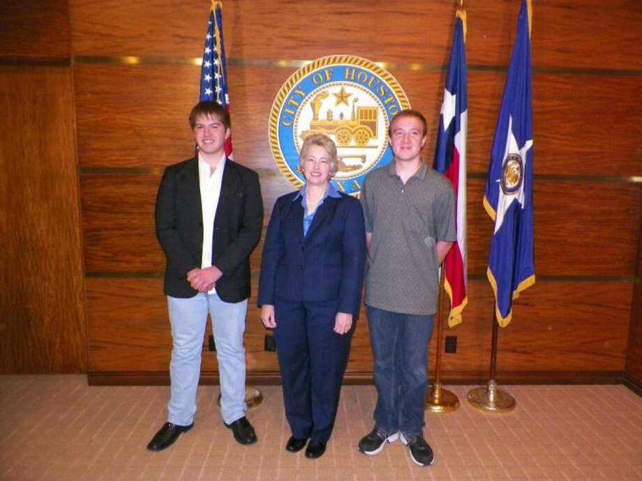 Mayor Annise Parker with Kingwood High School students Alec Dunbar and Ryan Murray. Photo: Submitted