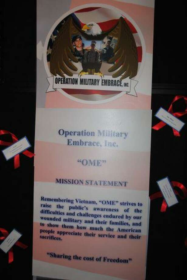 Operation Military Embrace, a non-profit organization started by Rosehill-area residents, provides gifts and essentials to wounded military and their families. The organization's logo is an eagle, representing America, embracing members of the military. The three men featured in the logo are two men wounded in recent combat, and the brother of one of the organization's founders, a Marine killed in Vietnam.