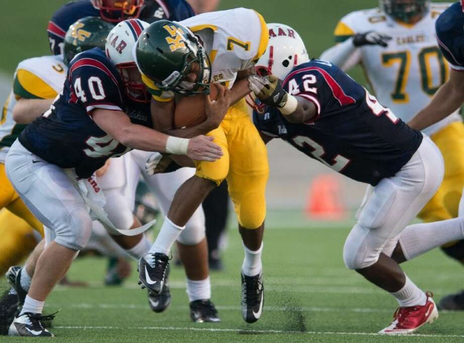The Lamar Redskins, shown here putting the squeeze on a Klein Forest runner two weeks ago, will travel to Beaumont West Brook later today to face the Bruins, who are 0-2 on the season. Linebacker Jack Anderson, left, and Jesus Aguirre are shown here making the tackle. The Redskins are 2-0 and after playing West Brook will play Alief Elsik at Delmar Stadium next Friday night to close out their non-district season. (Kevin Long / GulfCoastShots.com) Photo: Kevin B Long