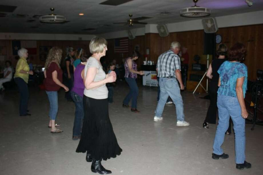 Men and women at the VFW Post 1839 groove to the cupid shuffle while DJ George turns up the tunes on Thursday's steak night.