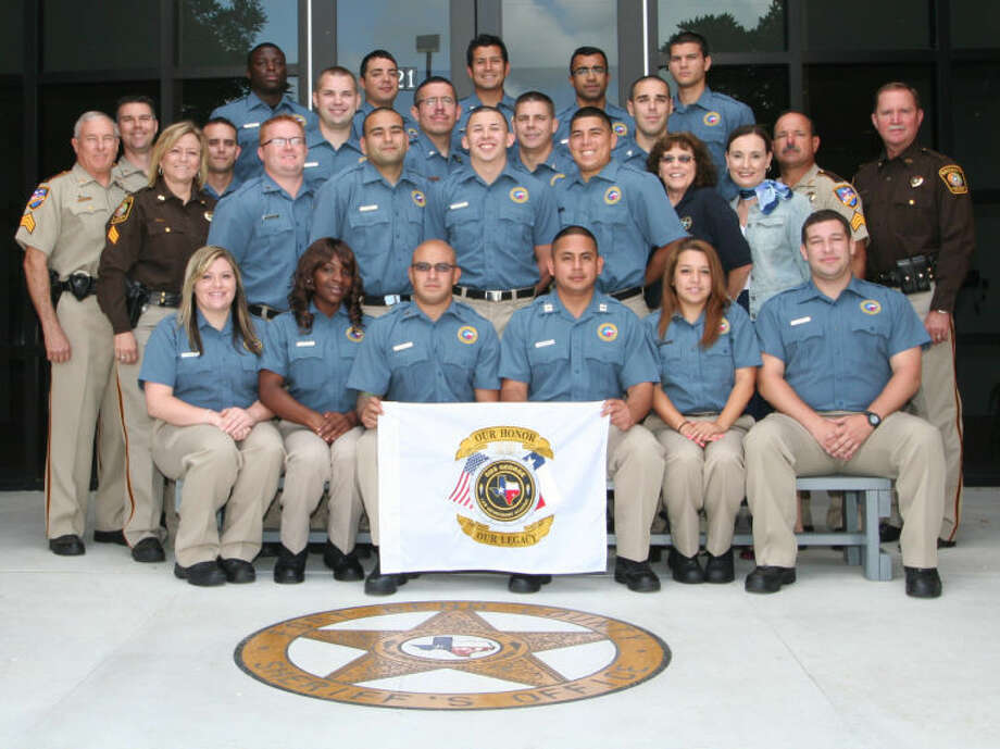 Graduates and instructors for the 28th Class of the Gus George Law Enforcement Academy include, front row, from left, Ashley Burns, Melissa Debose, David Beserra, Rigoberto Salazar, Audrey Rodriguez and Jeff Bartee. Second row: Sgt. Michael Lorenz, Sgt. Angie Womble, Cody Coudron, Tahir Afsar, Craigan Colunga, Pete Torres, Staff members Cindi Villemarire and Dottie Zumwalt, Sgt. Carlos Castillo and Captain Mike Patton. Third row: Lt. Matt Carter, Charlie Willeby, Richard Reiser, Pedro Soto, Gabriel Cernosek and Garrett Driscoll. Fourth row: Roderick Rainer, Wesley Hall, Raymond Ramirez, Zarak Alam and Michael Riehl.