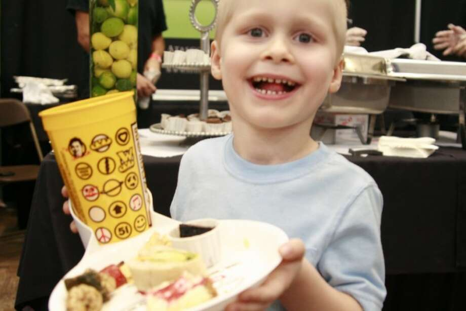 Elliot Gregory enjoys a plate full of food at the annual Tasting the Town Sept. 13.