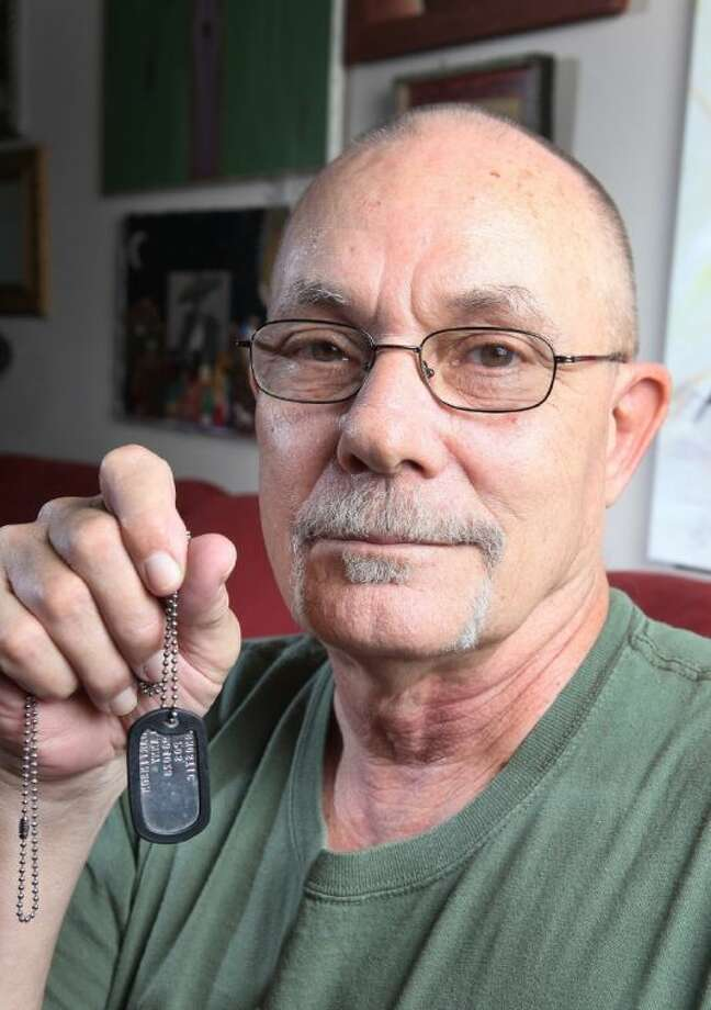 Retired Marine and Vietnam veteran Lanny Martinson holds up the dog tag that he ordered just three days before hearing that his original dog tag was found in Khe Sanh, Vietnam. He will receive his original dog tag in August. Martinson lost his right leg from a land mine on June 4, 1968, in Khe Sanh and lost his dog tags as he was medevaced out to a hospital.