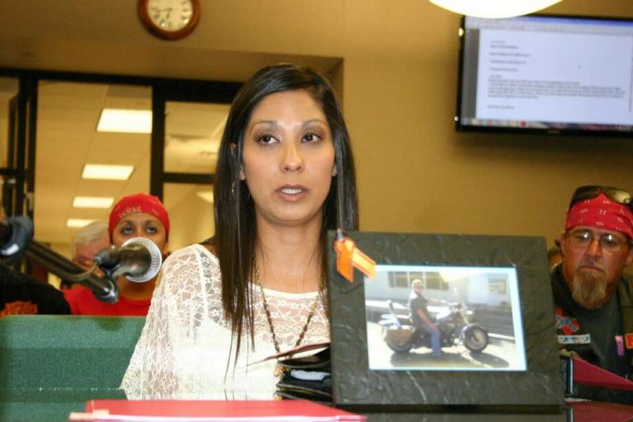 "Liberty resident Lina Rodriguez testifies Sept. 11 to Liberty City Council, urging the posting of ""Share the Road"" yellow signs to remind motorists to watch for motorcycles. In the photograph is Chas Soliday, husband of Dayton City Secretary Melinda Soliday. Chas was killed in October 2011 after his motorcycle collided with a pickup on Highway 90. Photo: STEPHEN THOMAS"
