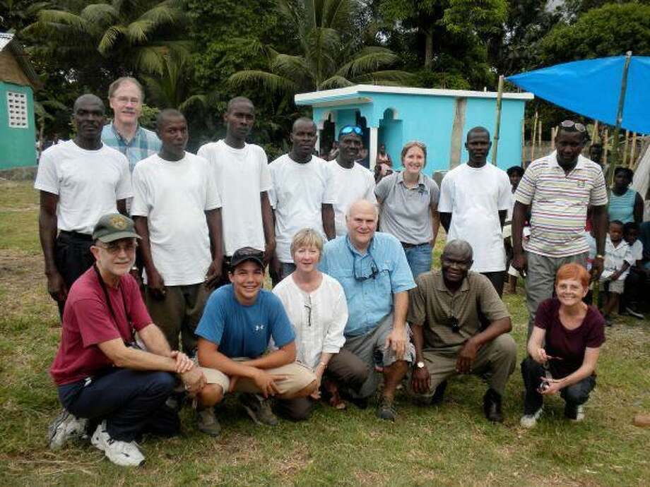 Members of the water mission with Haitian villagers.