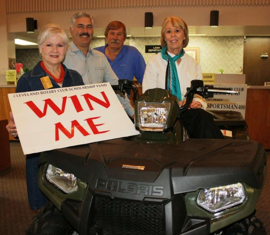 Members of the Cleveland Rotary Club display the 2013 Polaris 400 Sportsman H.D. four-wheeler that will be raffled off on Oct. 31 to raise money for scholarships. Shown from left to right are Roschelle Springfield assistant governor, Brad Browder, T.W. Garrett and Ernestine Belt, club president. Photo: MELECIO FRANCO