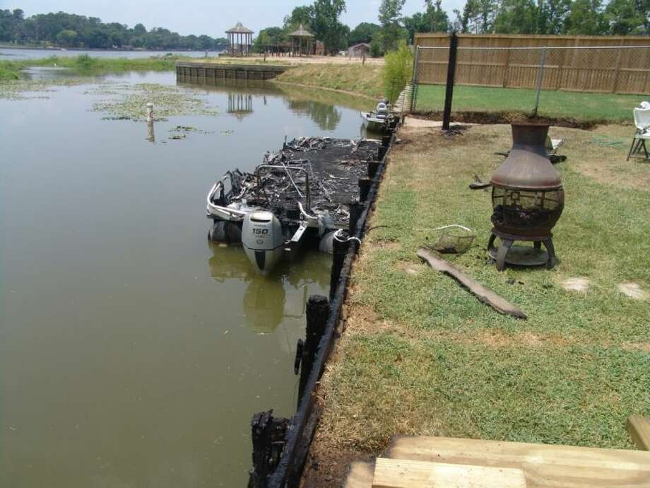 A charred interior is all that remains of a boat that caught fire Thursday night on Lake Conroe. Noticeable up front is the partially burned bulkhead, allegedly caused by embers from fireworks shot off in the area.