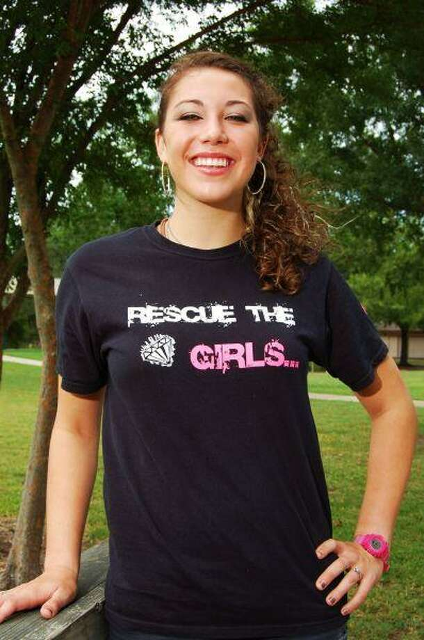 """Deer Park High School junior Tabitha Hawthorne designed her own t-shirts to help raise money for """"Hope of Home,"""" a facility that aims to help victims of human trafficking rings."""