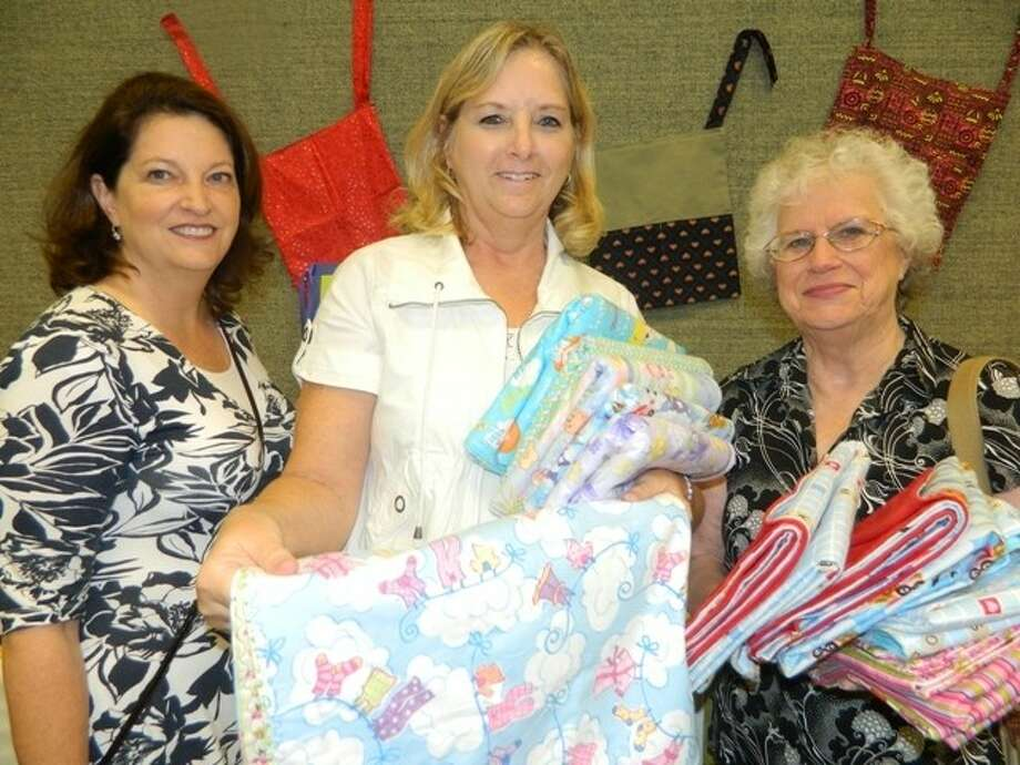 Suzanne Jamison (left), Marilyn Gilliland (center) and Alice Berges (right) attended the second annual Day of Service held by The Relief Society of The Church of Jesus Christ of Latter-day Saints. Women across the east Houston areas worked and donated for months to serve seven local charities. Photo: Submitted Photo