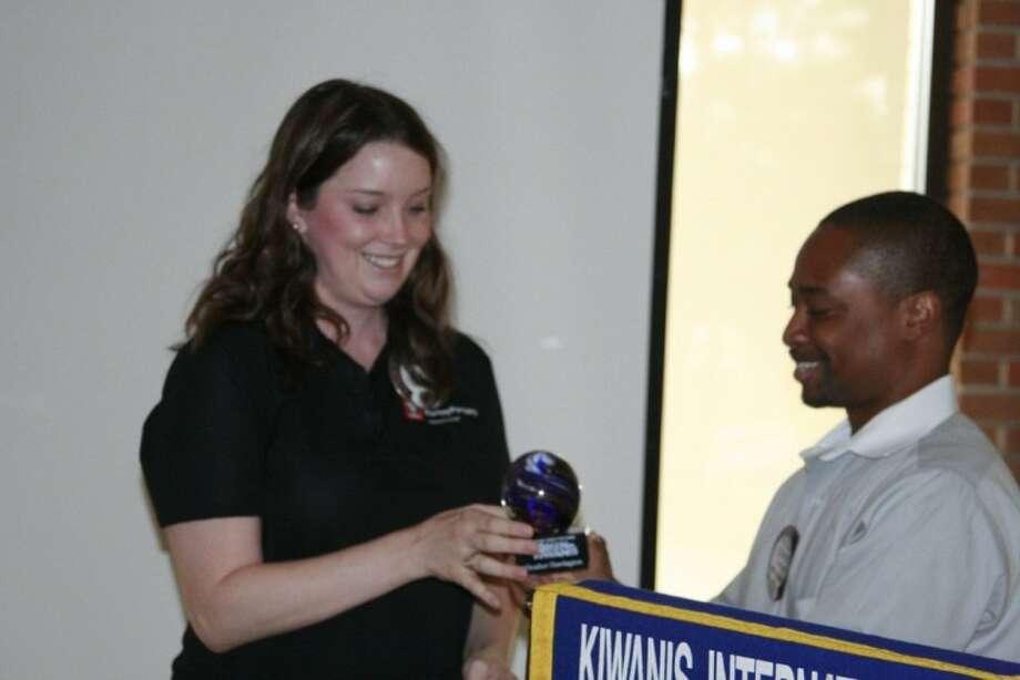 "Kiwanis Club of Kingwood president Corey Turner presents the ""Women of Kiwanis"" award to member Heather Harrington Sept. 14 as part of the 25 years of women in Kiwanis celebration."