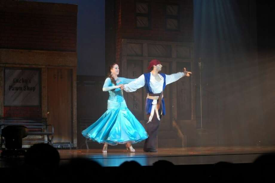 "Professional dancer Daniel Blain and student Tiffany Tosky perform to ""Pirates of the Caribbean"" at Fred Astaire Dance Studios annual Rhythm of the Night Ballroom Dance Spectacular."