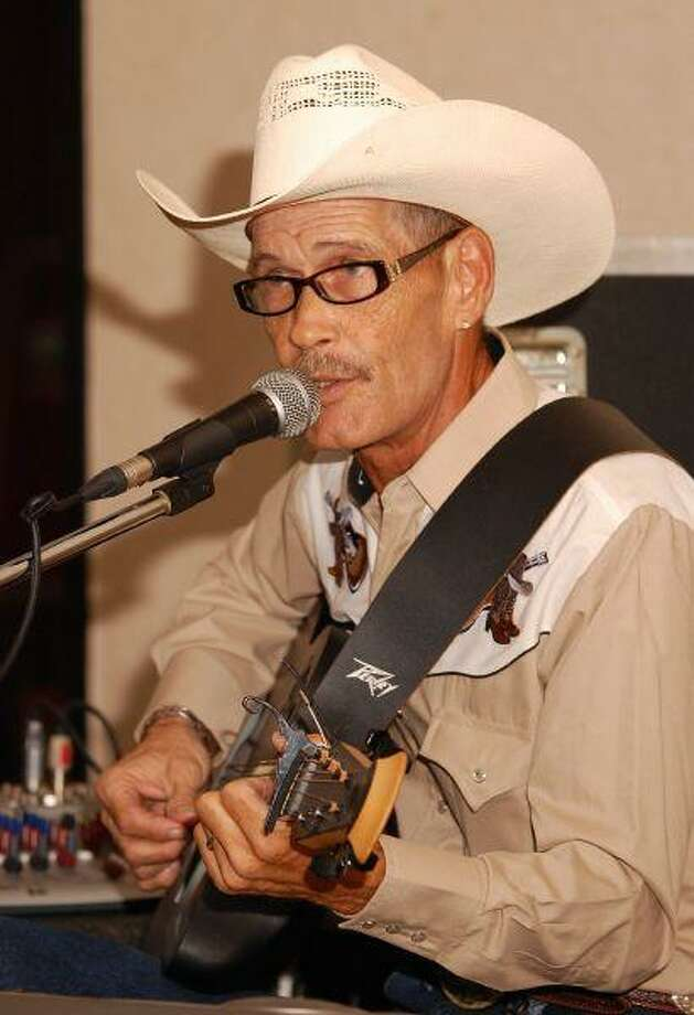 Louie Campbell plays along with his digital band as he entertains a gathered crowd at Deer Park's Republic Grill last Saturday night.