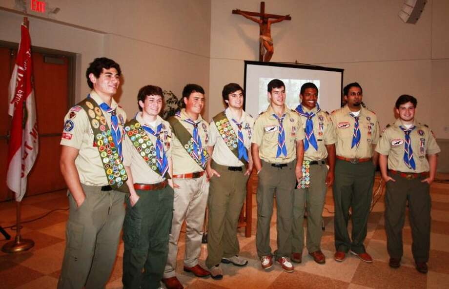 Eight Boy Scouts were awarded the rank of Eagle Scout at St. Vincent DePaul Church. From left to right, Nasim Dimassi, John Taylor, Daniel Maes, Addison Snelling, Jared Jallans, Gator Adams, Anand Mani and Matthew Richards.