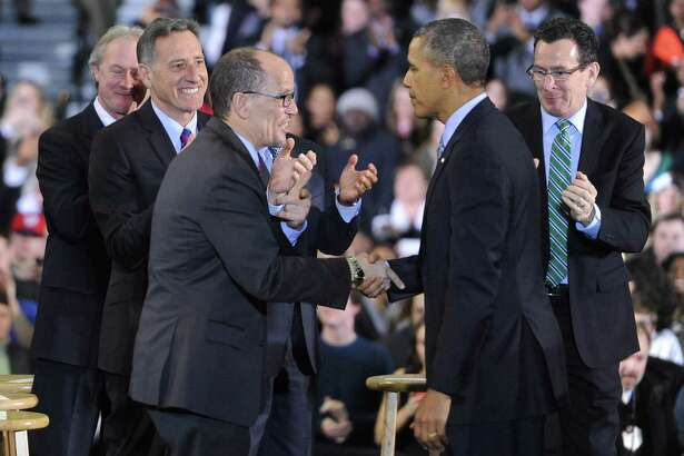 President Barack Obama with Secretary of Labor Thomas Perez in March 2014 in New Britain, Conn., joined by Connecticut Gov. Dannel P. Malloy, right.