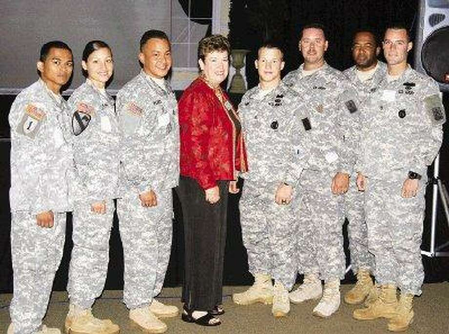 Keller Williams Realty Northeast co-owner Judy Hopkins, center, invited several area troops to join her at the monthly Kingwood Chamber of Commerce luncheon July 7. / @WireImgId=1445420