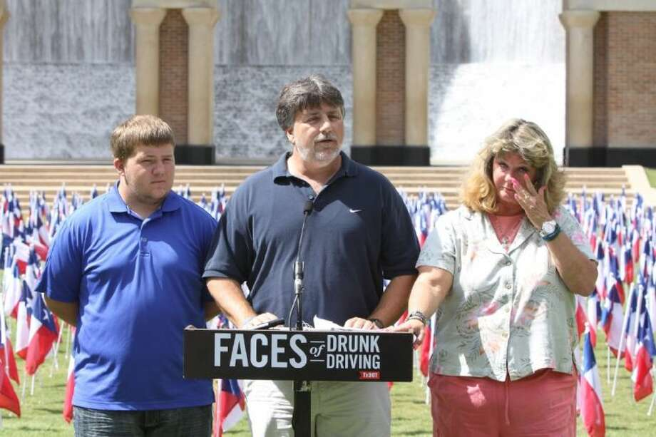 Dennis Pennywell talks about his son Aaron, killed in a drunk driving accident, during a launch of the Faces of Drunk Driving in front of the Gerald Hines Waterwall Park in Houston. Brother Jack is on left and mother Kae is on right. Pennywell was killed by a drunk driver who ran a stop light and struck his vehicle on June 25, 2011.