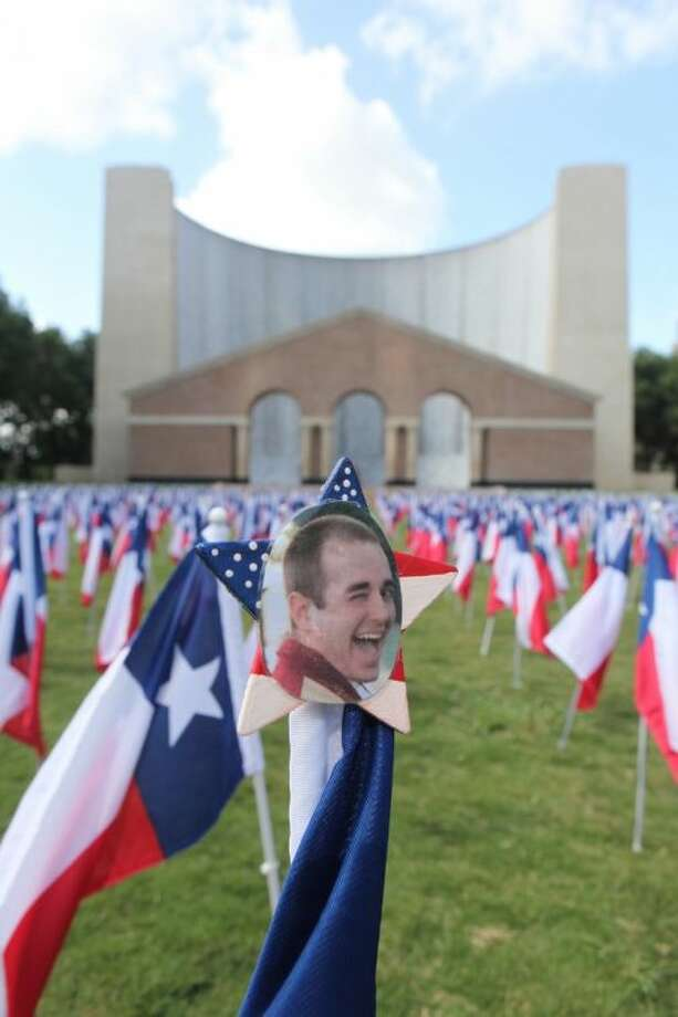 Aaron Pennywell's picture sits on top a Texas flag along with 1,170 Texas flags representing all the lives lost last year to drunk driving in front of the Gerald Hines Waterwall Park in Houston. Pennywell was killed by a drunk driver who ran a stop light and struck his vehicle on June 25, 2011.