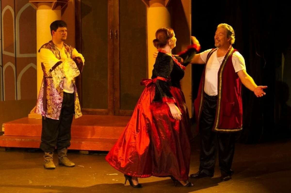 """Father (Matt Phillips) of Katherine the Terrible (Jennifer Gonzales) watches her interaction with Petruchio (Tim Nibert) in Clear Creek Community Theatre's """"Kiss Me, Kate,"""" based on Shakespeare's """"Taming of the Shrew."""" The hilarious play runs weekends through September 23. Call 281-335-5228 for complete information."""