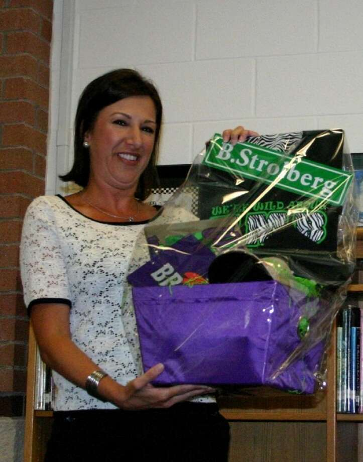 Starting this week as the new principal at Kimmie M. Brown Elementary School, Brandy Strolberg admires the gift basket that KMB faculty members present her. She comes from Tarkington Primary, where she held the same leadership position. Photo: STEPHEN THOMAS