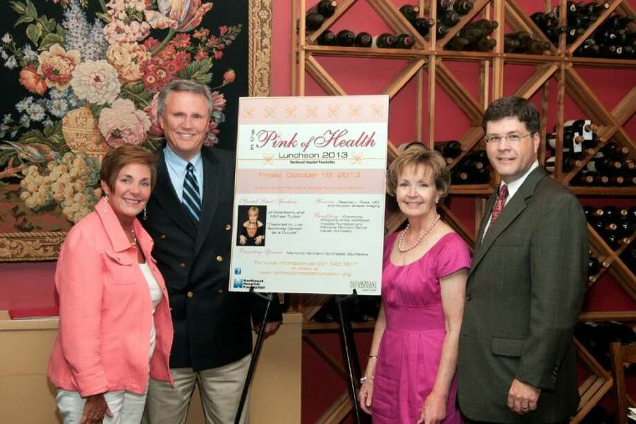 """Foundation President Norman Funderburk (second from left) and Memorial Hermann Northeast Hospital CEO Louis Smith discuss """"In the Pink of Health"""" plans with Devon Alexander(left) and Lynette Calfee, Host Committee co-chairs."""