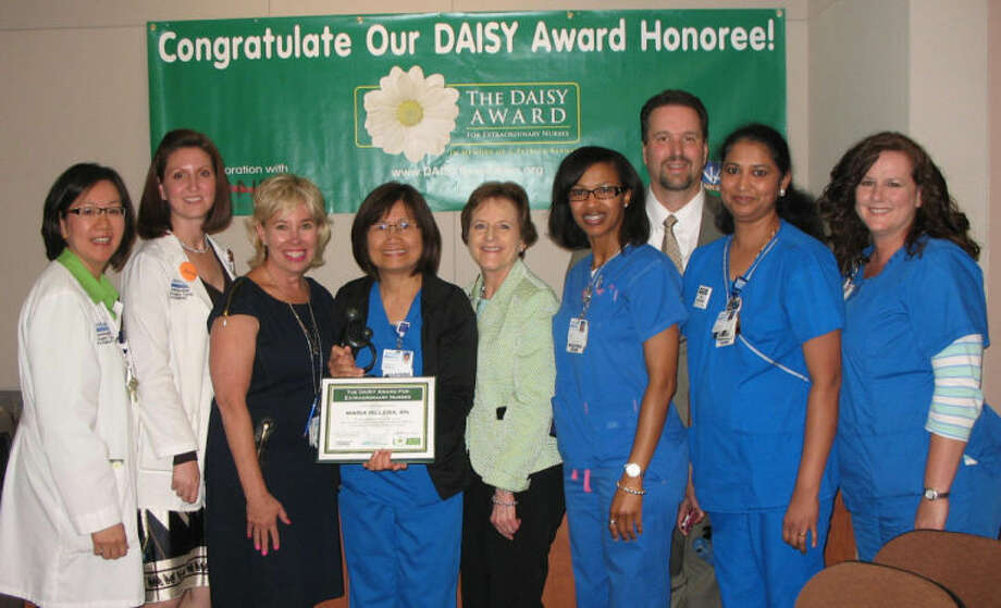 DAISY Award Recipient, Maria Rillera, RN, with the DAISY Award Committee.