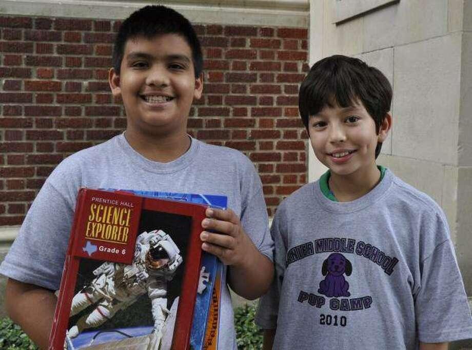 Sixth-graders Jorge Escobedo and Frank Valdez