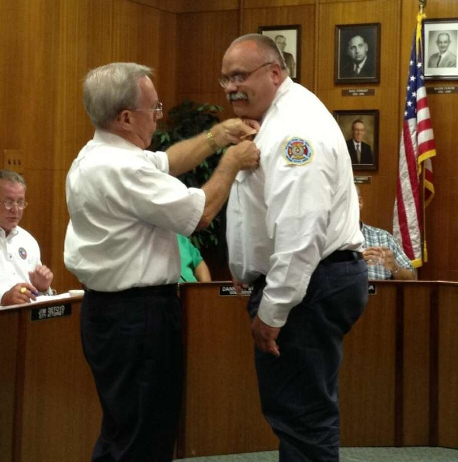 Paul Gregory (right) receives his pin as fire chief for Galena Park from Mayor Bobby Barrett during the city council meeting on Tuesday, July 2. Photo: Submitted Photo