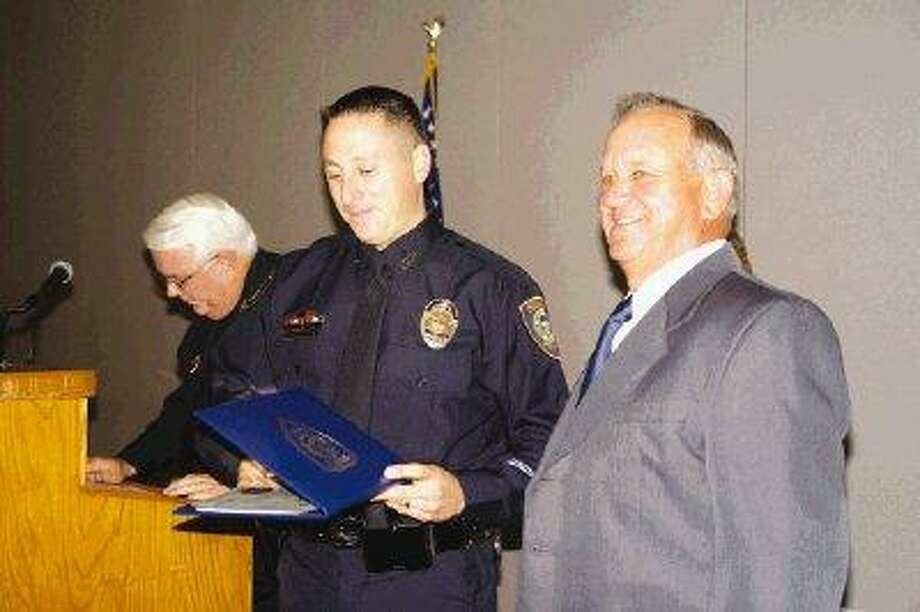 Not even a year ago, in September 2009, Humble Police Chief Gary Warman, right, and Assistant Chief Curtis Mills presented Officer Joe Martinez with the Officer of the Year Award for 2008. Now the former patrol officer turned jailer is suing both superiors, as well as the city of Humble, for retaliation.