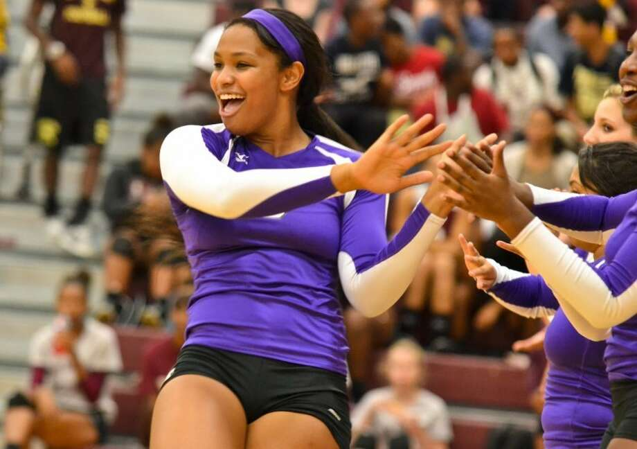 Lenecia Tyson hi-fives her teammates during pre-game introductions before Humble volleyball's match against Summer Creek Sept. 11. Photo: Photo By Stephen Whitfield