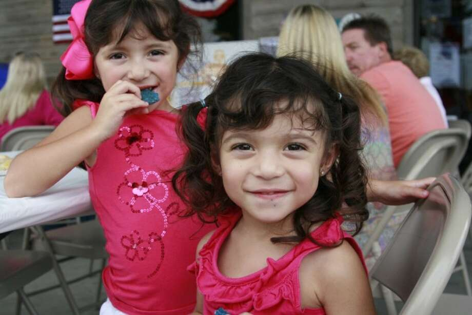 Alaina and Alisa Villagomez enjoyed patriotic cookies at Beckwith's Car Care Constitution Day Sept. 15.