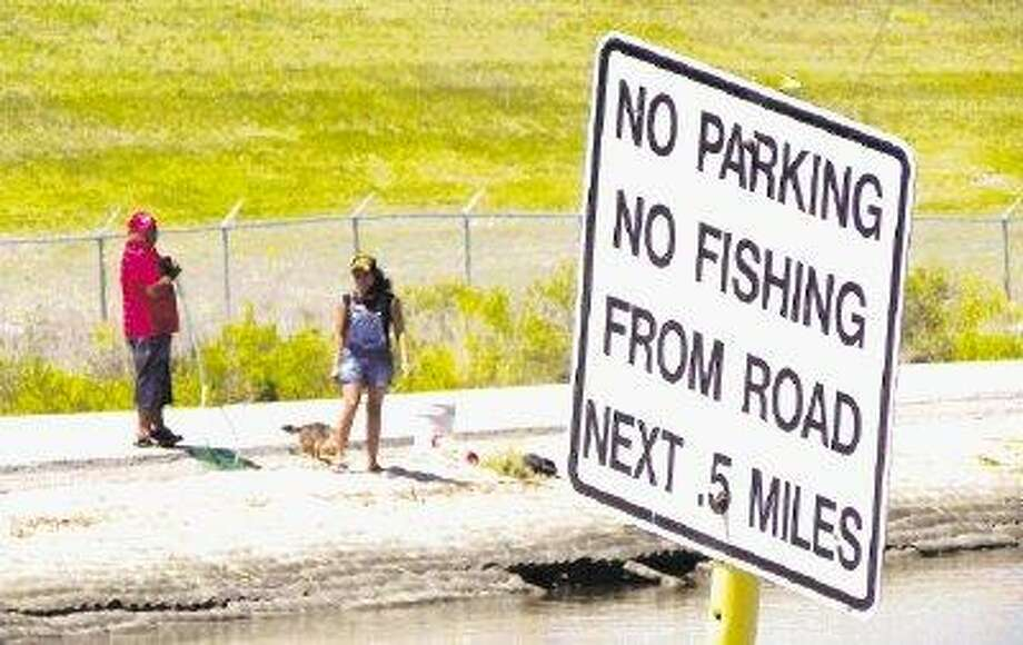 This sign warns the public against recreation on the contaminated San Jacinto River.