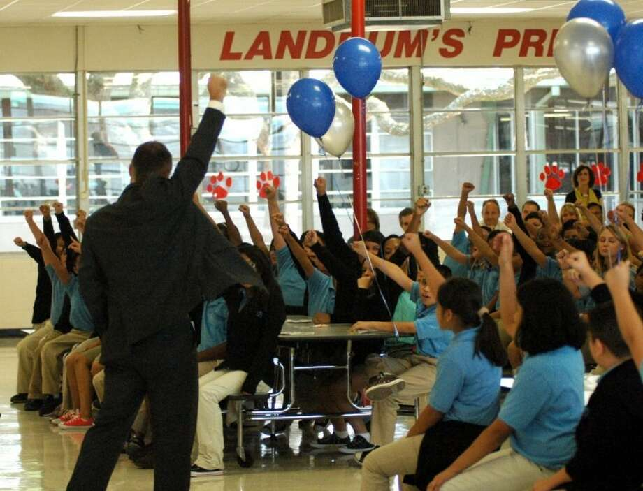 School leader Eric Schmidt leads KIPP Courage students in a chant at last week's grand opening. KIPP Courage opened at Landrum Middle School as part of the SKY Partnership between KIPP, Spring Branch ISD and YES Prep Academy.