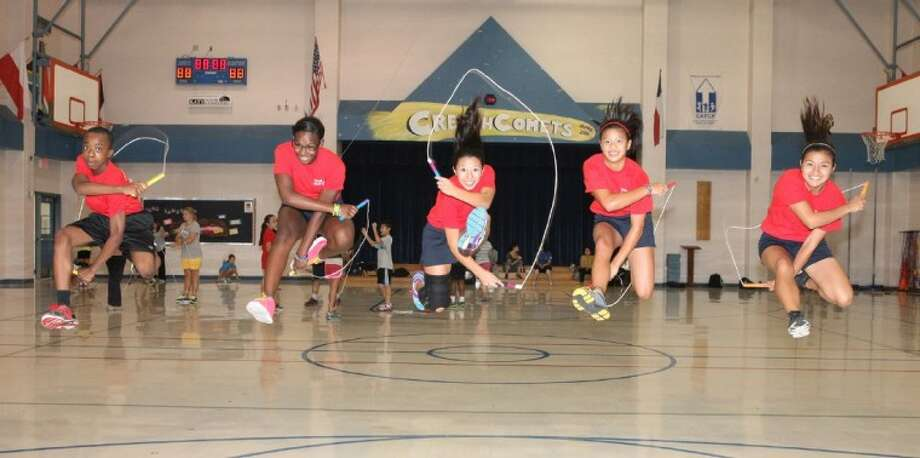 (L to R) Patrick Anaemejeh, Kalisia Brisco, Sarah Phan, Camryn Lam, and Elizabeth Garcia of the Team USA Jump Rope Team preform trick jumps during practice at Creech Elementary School in Katy.
