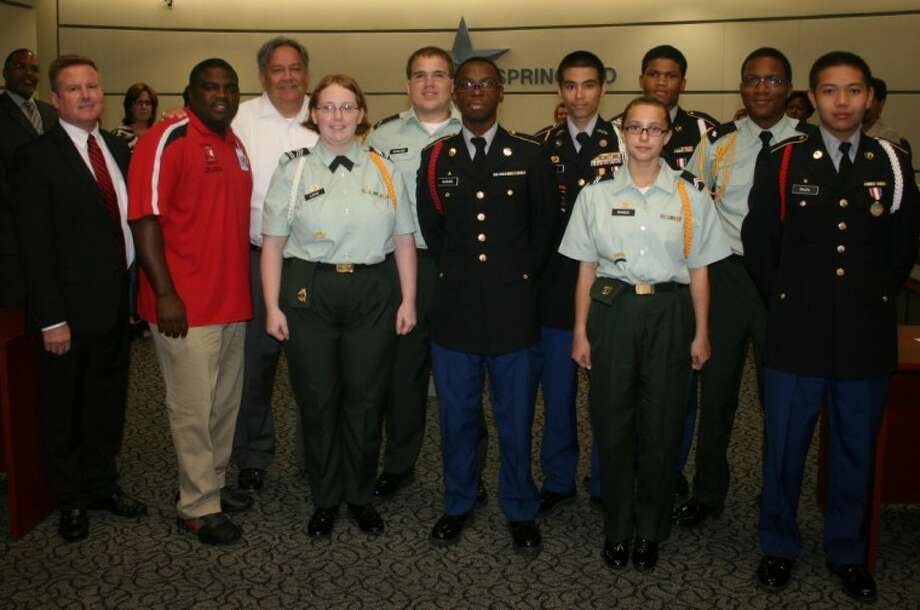 Westfield High School Army JROTC cadets were recognized at the September Board of Trustees meeting. Pictured front row, from left, are Westfield Principal Steve Kinney, 1st Sgt. Carlo Jackson, Cadet Arriane Lowe, Cadet Kerry Hughes, Cadet Katherine Senter and Cadet Mark Penaranda. Back row, from left, are Cadet Nathan Rawlins, Cadet Chris Jovel, Cadet Anthony Smith and Cadet Quanzel Caston. Photo: Unknown