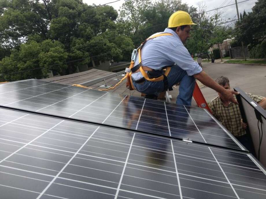 HCC Central electrical students work with industry professionals to install the first of several solar panels in preparation for the college's new solar-energy program. Fall classes begin at HCC Central August 26.