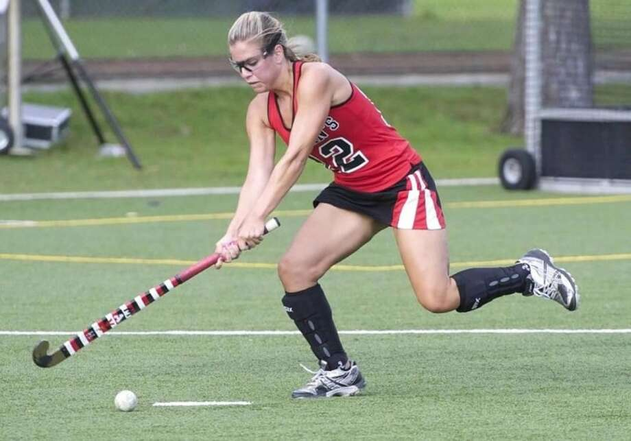 St. John's School senior and captain Natalie Plummer makes a defensive shot at the recent St. John's School versus The Kinkaid School game. Plummer leads a defensive crew that has held the opposition to just four goal during the first month of the field hockey season.