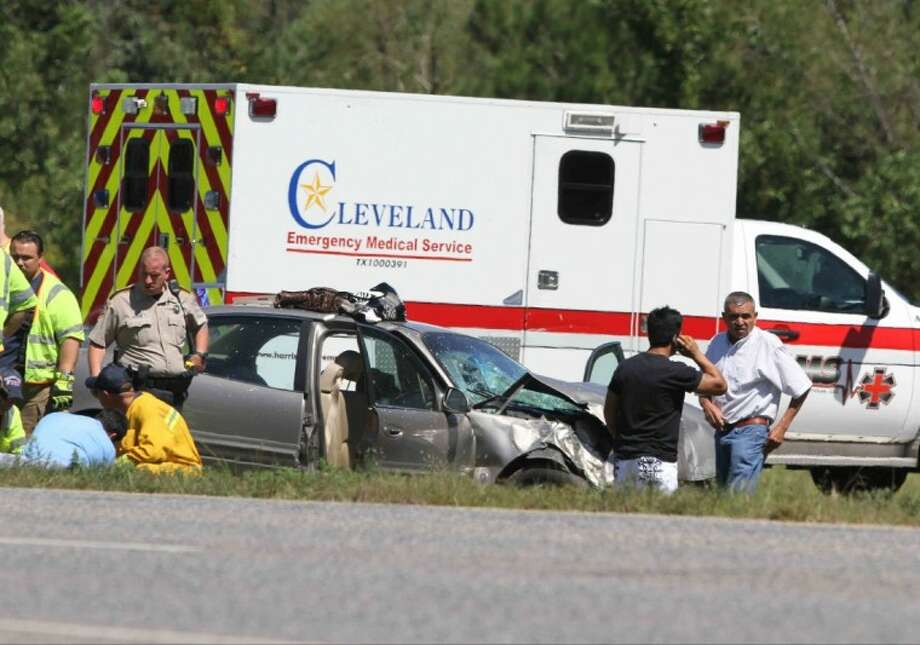 Law enforcement and emergency personnel work the scene of a two car accident just south of Cleveland on Sept. 19, 2012. Photo: JASON FOCHTMAN