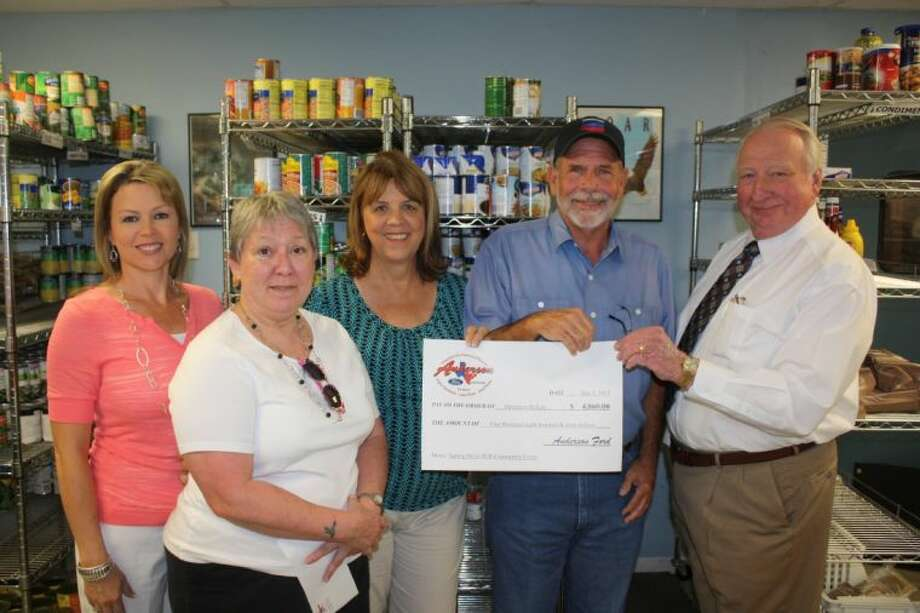 Anderson Ford donated $4,860 to support the endeavors of Operation Refuge in Cleveland. Pictured left to right are: Teresa Coats, Operation Refuge board member; Sharon Anderson, of Anderson Ford; Frieda White, Operation Refuge board president; Jim Whitener, Operation Refuge board member; and Alfred Anderson, of Anderson Ford.