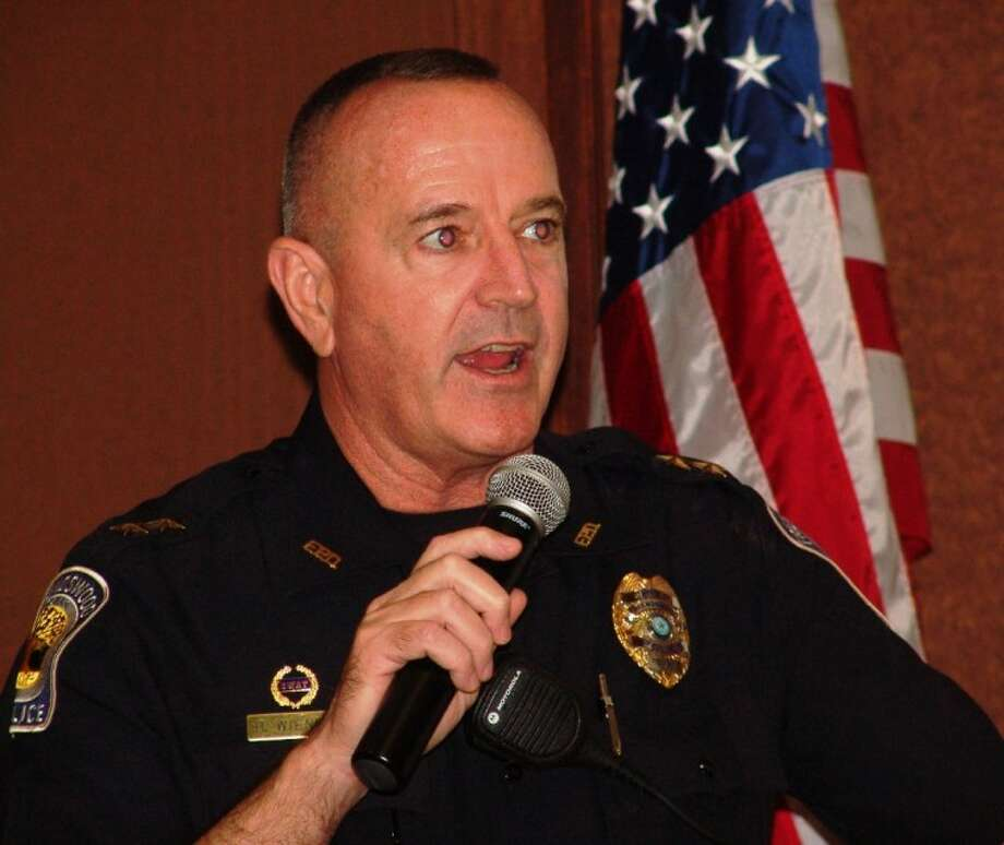 Friendswood Police Chief Robert Wieners presents crime stats to the Chamber of Commerce luncheon. Photo: JEFF NEWPHER