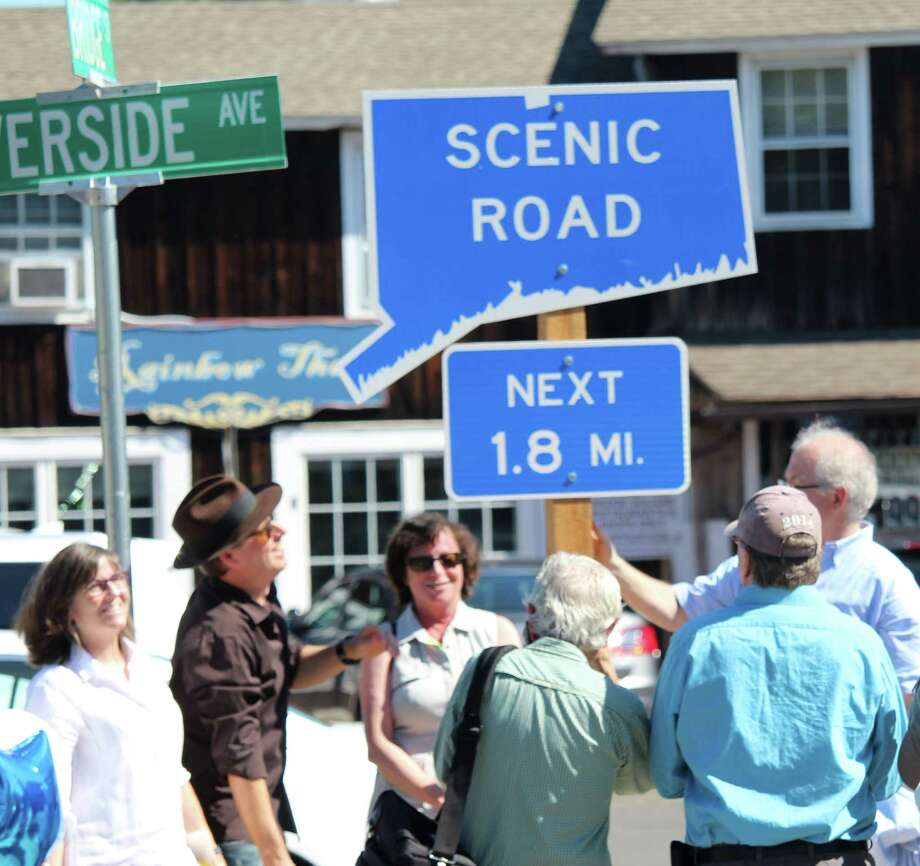 Morley Boyd and John Suggs admire the nelwy implemented scenic road sign on Route 136. The 1.8 mile scenic road, only the second in Westport, starts at the west end of the Bridge Street Bridge, officially known as the William F. Cribari Memorial Bridge.The designation runs until Route 136 intersects with the Post Road and Compo Road S. Photo: Chris Marquette / Hearst Connecticut Media / Westport News