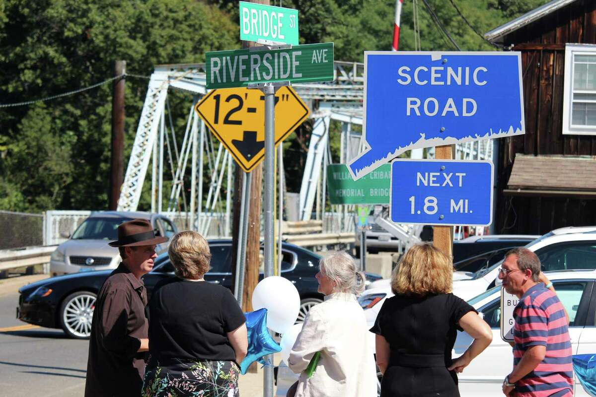 A group stands around to admire the nelwy implemented scenic road sign on Route 136. The 1.8 mile scenic road, only the second in Westport, starts at the west end of the Bridge Street Bridge, officially known as the William F. Cribari Memorial Bridge.The designation runs until Route 136 intersects with the Post Road and Compo Road S.