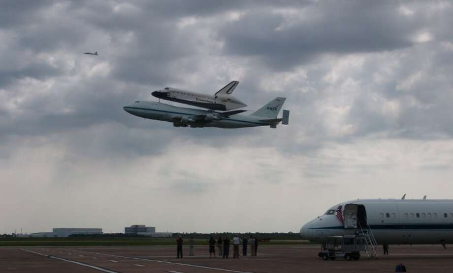 Endeavour, on top of a NASA modified 747, makes a low altitude pass at Ellington Airport.