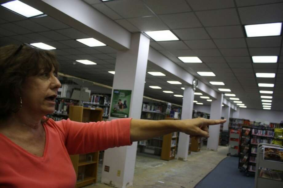As staff readies for the Deer Park Public Library temporary closing, news services librarian Peggy Warnock is looking forward to the change of scenery. Photo: Y.C. OROZCO