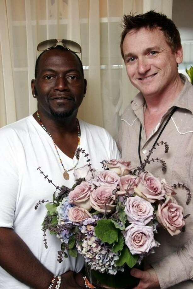 Doyle Borden, a 1984 New Caney High School graduate, poses with American Idol Judge Randy Jackson in Los Angeles at a recent event.