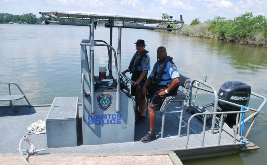 Houston Police Department Lake Patrol Officers Charles Dotson and Officer Genarrow Patton patrol Lake Houston to make sure boaters aren't intoxicated and that children are wearing life jackets. Photo: Anthony J. Turner
