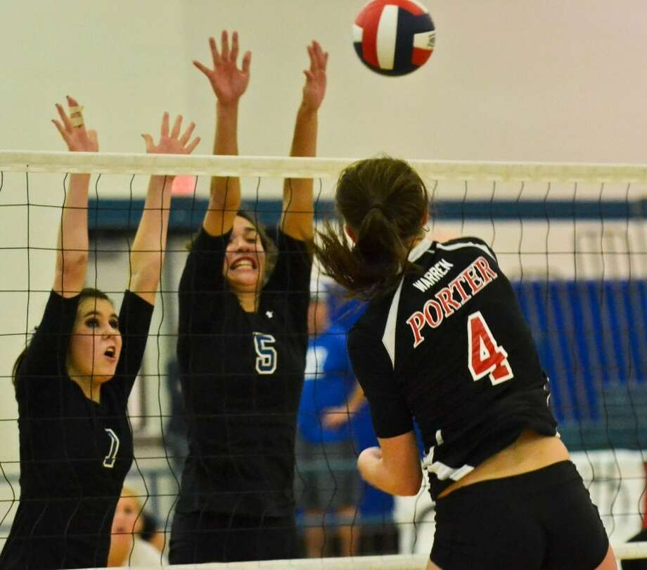Samantha Warren (4) spikes a ball past the outstretched arms of Paige Gill (1) and Angel Nealy (5) in Porter volleyball's 3-0 win over New Caney Sept. 18. Photo: Photo By Stephen Whitfield