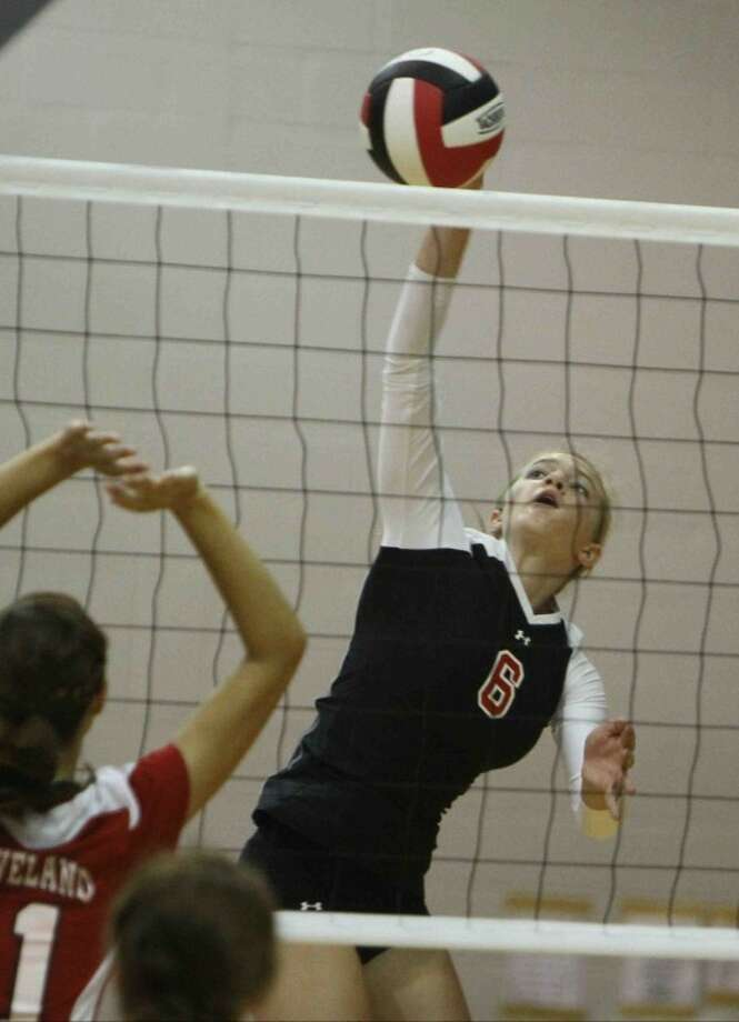 Huffman's Lara Wilkins (6) gets a shot off against Cleveland during a high school volleyball game at Huffman High School on Sept. 18. Photo: Photo By Jason Fochtman